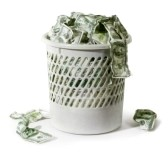 7964694-close-up-of-million-dollars-in-trash-on-a-white-background